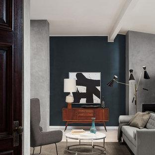 Esempio di un soggiorno moderno di medie dimensioni e aperto con sala formale, pareti verdi, pavimento in gres porcellanato, camino classico, cornice del camino in cemento, nessuna TV e pavimento beige