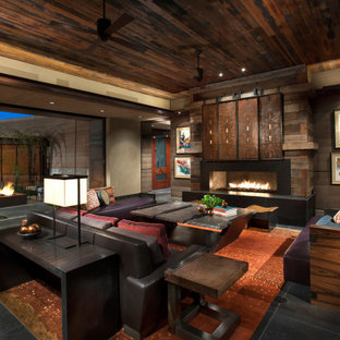 Formal open plan living room in Phoenix with brown walls, a ribbon fireplace, black floors and a wood ceiling.