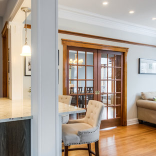 This is an example of a mid-sized traditional open concept living room in Chicago with a home bar, grey walls and medium hardwood floors.