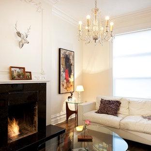 Trendy enclosed dark wood floor living room photo in Ottawa with beige walls