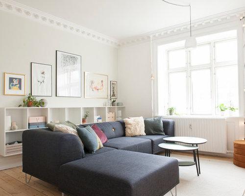 Example Of A Danish Medium Tone Wood Floor And Brown Floor Living Room  Design In Chicago