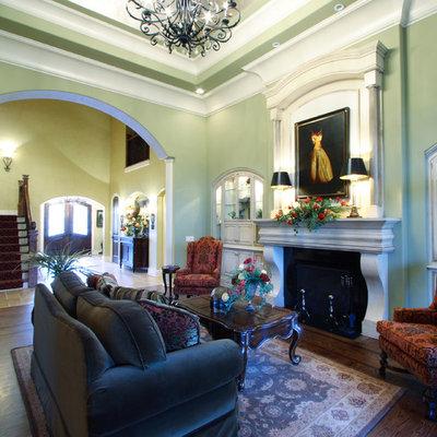 Elegant living room photo in Cincinnati with green walls