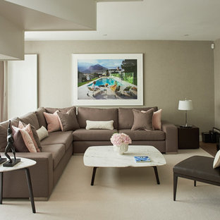 Design ideas for a contemporary enclosed living room in London with brown walls, carpet and a wall mounted tv.