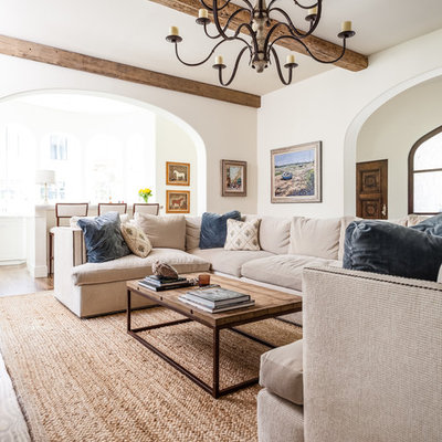 Example of a tuscan living room design in Dallas with white walls