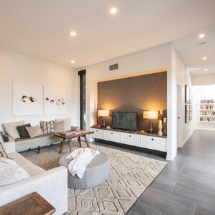 Inspiration for a large contemporary living room in Other with white walls, porcelain floors, a freestanding tv and grey floor.