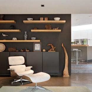 Modelo de salón para visitas abierto, contemporáneo, con paredes negras y suelo de cemento