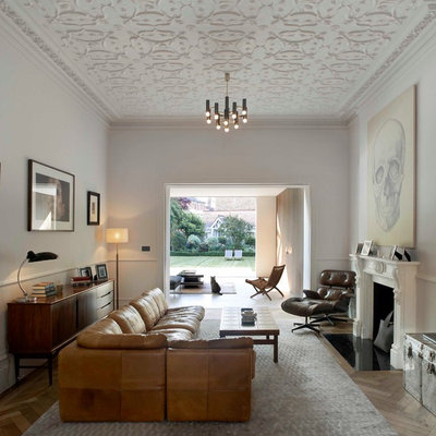 Living room - transitional living room idea in London with a standard fireplace