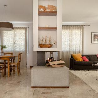 Cette image montre un salon design ouvert et de taille moyenne avec un mur blanc, une cheminée double-face, une salle de réception et aucun téléviseur.