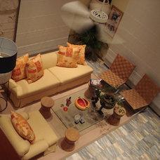 Tropical Living Room by de'Shea Interiors, Inc.