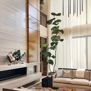 Immagine di un ampio soggiorno classico aperto con sala formale, pareti beige, pavimento in marmo, camino lineare Ribbon, cornice del camino in pietra e pavimento beige