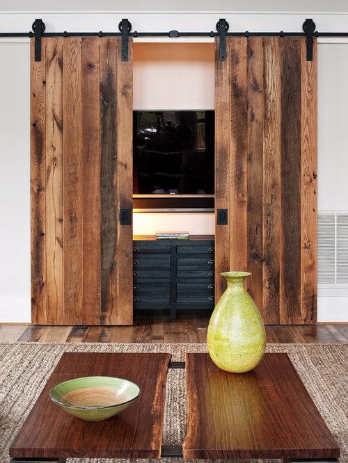 Barn door hide tv houzz for B q living room doors