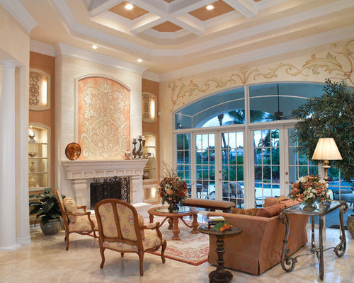 Example Of A Tuscan Marble Floor Living Room Design In Miami With Beige Walls And No