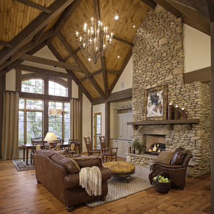 Mountain style open concept living room photo in Other with a standard fireplace and a stone fireplace