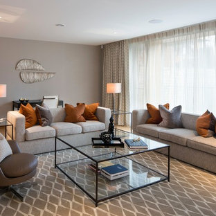 Inspiration for a traditional formal living room in London with grey walls, light hardwood flooring and brown floors.