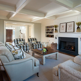 Photo of a large classic formal enclosed living room in Philadelphia with white walls, a standard fireplace, a built-in media unit, carpet, a stone fireplace surround and grey floors.