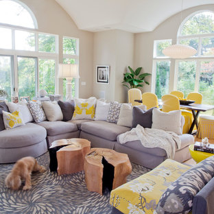 Design ideas for a contemporary open plan living room in Miami with beige walls and light hardwood flooring.