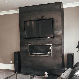 Immagine di un soggiorno chic di medie dimensioni e aperto con pareti grigie, parquet scuro, camino lineare Ribbon, cornice del camino in cemento e TV a parete