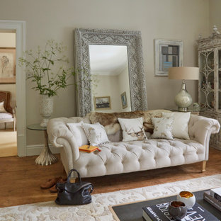 Photo of a large enclosed living room in Other with beige walls, medium hardwood flooring and brown floors.