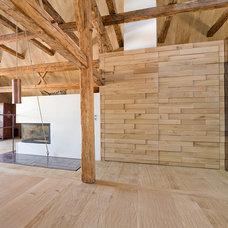 Rustic Living Room by AREA Handelsgesellschaft mbH - Salzburg
