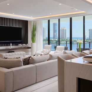 Example of a trendy white floor living room design in Miami with beige walls and a wall-mounted tv
