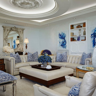 Example of an ornate enclosed carpeted and beige floor living room design in Miami with beige walls