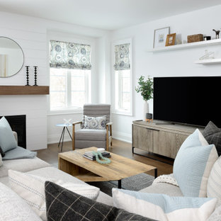 Inspiration for a large transitional open concept medium tone wood floor and brown floor living room remodel in Toronto with white walls, a standard fireplace, a shiplap fireplace and a tv stand