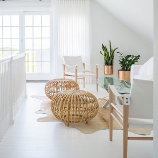 Inspiration for a beach style open concept painted wood floor and white floor living room remodel in New York with white walls
