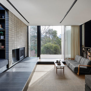 Mid-sized contemporary open concept living room in Melbourne with grey walls, vinyl floors, a standard fireplace, a brick fireplace surround, a wall-mounted tv, beige floor, recessed and wallpaper.