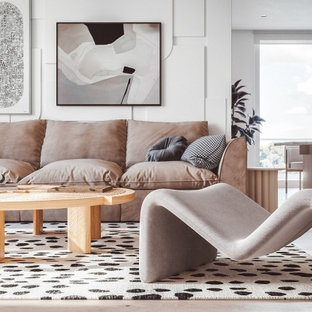 Design ideas for a mid-sized contemporary open concept living room in Sydney with white walls, a wall-mounted tv, light hardwood floors and beige floor.