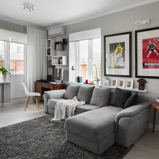Photo of a classic enclosed living room in London with grey walls, light hardwood flooring and grey floors.