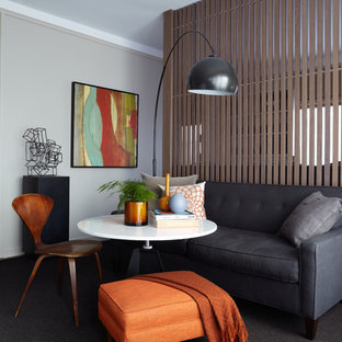 Inspiration for a small modern living room remodel in New York with beige walls