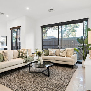 Design ideas for a transitional open concept living room in Melbourne with white walls and beige floor.