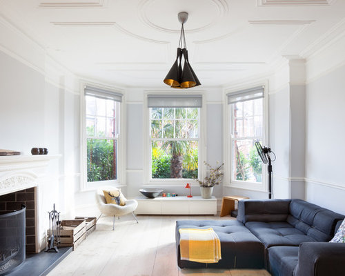 Design Ideas For A Classic Enclosed Living Room In London With Grey Walls,  Light Hardwood