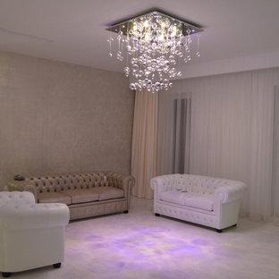 Immagine di un soggiorno design di medie dimensioni e aperto con pareti bianche e pavimento in laminato
