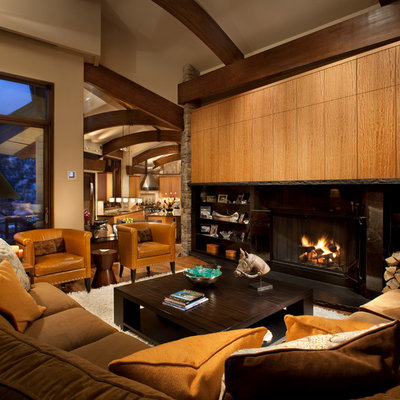 Living room - mid-sized contemporary formal and open concept medium tone wood floor living room idea in Denver with beige walls, a standard fireplace, a metal fireplace and no tv