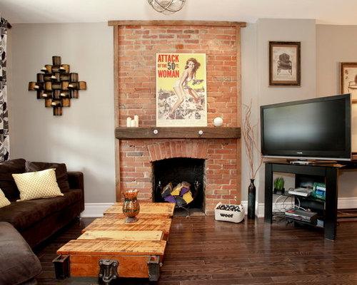 Example of an eclectic living room design in Other with a brick fireplace