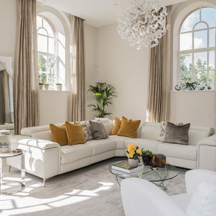 This is an example of a traditional formal open plan living room in London with beige walls and carpet.