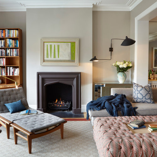 Example Of A Trendy Living Room Design In London With Gray Walls And A  Standard Fireplace