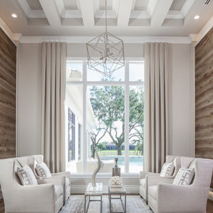 Example of a transitional formal and enclosed medium tone wood floor and beige floor living room design in Other with beige walls