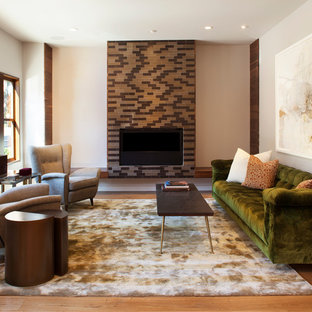 Example of a trendy medium tone wood floor living room design in San Francisco with a standard fireplace and a tile fireplace