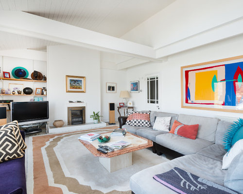 Example of a large trendy enclosed carpeted living room design in Devon  with white walls Coastal Living Room Houzz