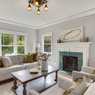Example of a mid-sized arts and crafts formal medium tone wood floor living room design in Seattle with gray walls, a standard fireplace, a tile fireplace and no tv