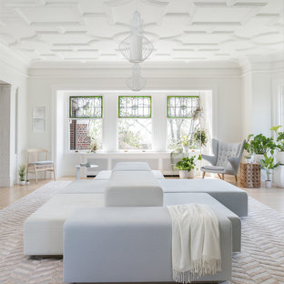 Inspiration for a transitional enclosed light wood floor and beige floor living room remodel in Seattle with white walls