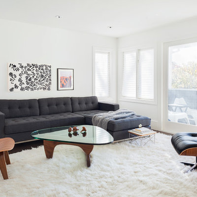 Example of a transitional formal and enclosed dark wood floor living room design in Vancouver with white walls