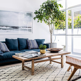 Photo of a scandinavian living room in Sydney with white walls, light hardwood floors and beige floor.