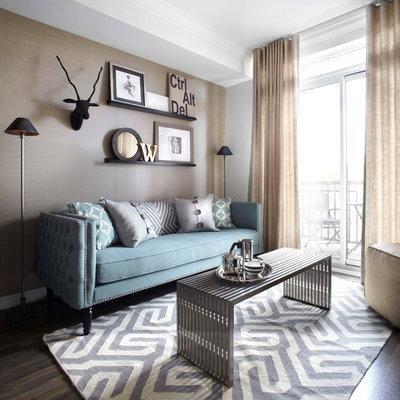 Example of a small trendy open concept dark wood floor and brown floor living room design in Toronto with beige walls