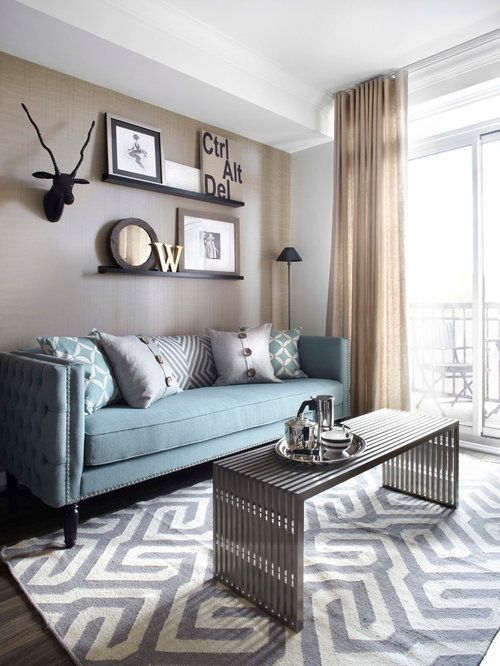 Example of a small trendy open concept living room design in Toronto with beige walls