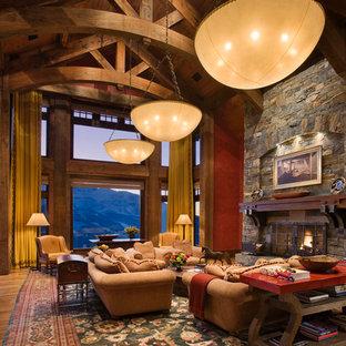Exemple d'un très grand salon montagne avec une cheminée standard et un manteau de cheminée en pierre.