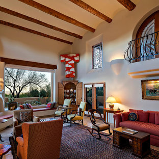 Example of a southwest living room design in Phoenix with white walls, a corner fireplace and no tv