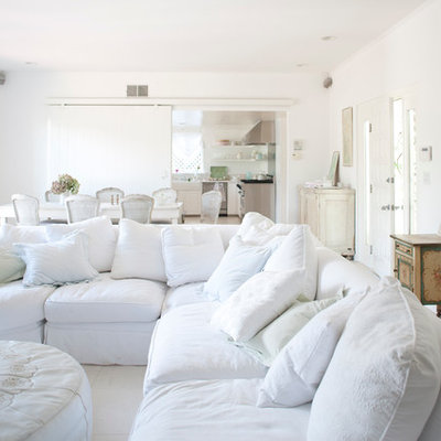 Example of a mid-sized cottage chic open concept living room design in Los Angeles with white walls